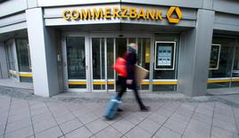 A pedestrian walks past a branch of Commerzbank located in its headquarters before the bank's annual news conference in Frankfurt, Germany, February 12, 2016.      REUTERS/Ralph Orlowski/File Photo