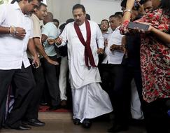 Fists fly as Sri Lankan MPs protest changing of the guard for ex-president