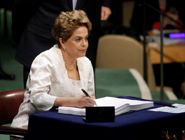 Brazilian President Dilma Rousseff signs the Paris Agreement on climate change at United Nations Headquarters in Manhattan, New York, U.S., April 22, 2016. REUTERS/Carlo Allegri