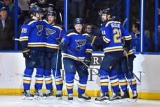 May 3, 2016; St. Louis, MO, USA; St. Louis Blues right wing Vladimir Tarasenko (center) celebrates with teammates after scoring a goal against the Dallas Stars during the second period in game three of the second round of the 2016 Stanley Cup Playoffs at Scottrade Center. Mandatory Credit: Jasen Vinlove-USA TODAY Sports