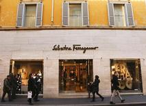 People walks past a Salvatore Ferragamo shop in downtown Rome, Italy February 10, 2016. REUTERS/Tony Gentile