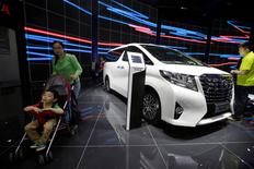 Visitors walk around a Toyota Alphard presented during the Auto China 2016 auto show in Beijing, China May 4, 2016. REUTERS/Jason Lee
