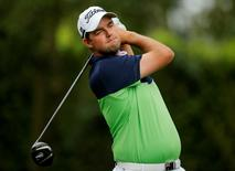 Marc Leishman of Australia hits his tee shot on the second hole during first round play in the 2013 Masters golf tournament at the Augusta National Golf Club in Augusta, Georgia, April 11, 2013.   REUTERS/Brian Snyder