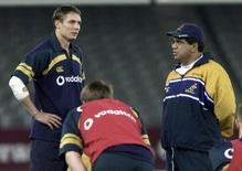 The Australian rugby team assistant coach Glen Ella (R) talks with Wallaby flyhalf Stephen Larkham (L) at a training run at Colonial Stadium July 6, 2001, venue for the second test match against the British and Irish Lions in Melbourne on July 7.  Reuters
