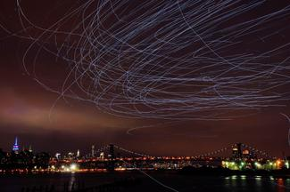 Pigeons light up New York skies