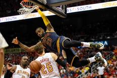 May 6, 2016; Atlanta, GA, USA; Cleveland Cavaliers forward LeBron James (23) dunks over Atlanta Hawks guard Kyle Korver (26) during the second half in game three of the second round of the NBA Playoffs at Philips Arena. Mandatory Credit: Dale Zanine-USA TODAY Sports