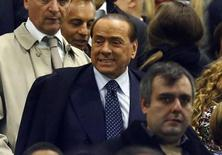 AC Milan's president and former Italian Prime Minister Silvio Berlusconi arrives before the match against Fiorentina at San Siro stadium in Milan, October 26, 2014. REUTERS/Stefano Rellandini