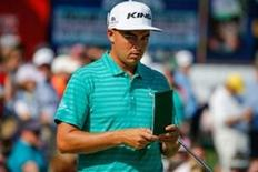 May 7, 2016; Charlotte, NC, USA;  Rickie Fowler (USA) looks over his scorecard during the third round of the 2016 Wells Fargo Championship at Quail Hollow Club. Mandatory Credit: Jim Dedmon-USA TODAY Sports