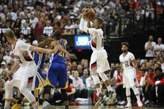 May 7, 2016; Portland, OR, USA; Portland Trail Blazers guard Damian Lillard (0) shoots a jump shot over the Golden State Warriors defense in game three of the second round of the NBA Playoffs at Moda Center at the Rose Quarter. Mandatory Credit: Jaime Valdez-USA TODAY Sports