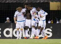 May 7, 2016; Columbus, OH, USA; Montreal Impact forward Dominic Oduro (7) celebrates with teammates after tying the tame against Columbus Crew SC at MAPFRE Stadium. Mandatory Credit: Greg Bartram-USA TODAY Sports