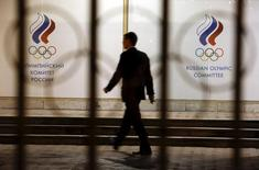 A man walks in front of the Russian Olympic Committee headquarters building, which also houses the management of Russian Athletics Federation in Moscow, Russia, November 13, 2015.  REUTERS/Sergei Karpukhin