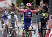 Lampre Merida rider Diego Ulissi of Italy celebrates as he crosses the finish line after the 264 km (164 miles) seventh stage of the 98th Giro d'Italia (Tour of Italy) cycling race from Grosseto to Fiuggi, Italy, May 15, 2015. REUTERS/LaPresse/Fabio Ferrari - RTX1D59M