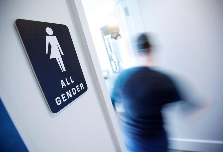 A bathroom sign welcomes both genders at the Cacao Cinnamon coffee shop in Durham  North. North Carolina transgender battle could expand civil rights law