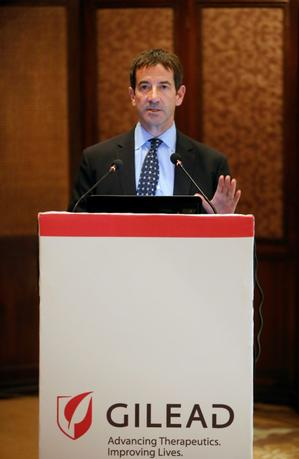 File photo of Gregg Alton, Gilead's executive vice president, corporate and medical affairs, speaking with the media during a news conference in New Delhi September 15, 2014. REUTERS/Anindito Mukherjee