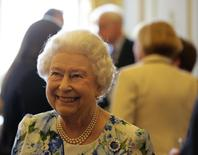 Britain's Queen Elizabeth smiles during a reception with parliamentarians to mark the Queen's 90th birthday at Buckingham Palace in London, Britain May 10, 2016.   REUTERS/Paul Hackett