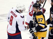 May 10, 2016; Pittsburgh, PA, USA; Washington Capitals left wing Alex Ovechkin (8) and Pittsburgh Penguins center Sidney Crosby (87) shake hands after game six of the second round of the 2016 Stanley Cup Playoffs at the CONSOL Energy Center.  Mandatory Credit: Charles LeClaire-USA TODAY Sports