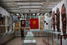 A staff member cleans an exhibition hall displaying images of late Chinese chairman Mao Zedong and pictures taken in the 1960-70s at Jianchuan Museum Cluster in Anren, Sichuan Province, China, May 13, 2016.  REUTERS/Kim Kyung-Hoon