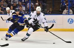 May 15, 2016; St. Louis, MO, USA; St. Louis Blues center Jori Lehtera (12) reaches for the puck on San Jose Sharks center Patrick Marleau (12) during the second period in game one of the Western Conference Final of the 2016 Stanley Cup Playoffs at Scottrade Center. Mandatory Credit: Jasen Vinlove-USA TODAY Sports