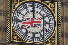 A British Union flag flutters in front of one of the clock faces of the 'Big Ben' clocktower of The Houses of Parliament in central London, Britain, February 22, 2016. REUTERS/Toby Melville/File Photo