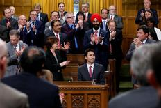 Canada's Prime Minister Justin Trudeau (seated) receives a standing ovation after delivering a formal apology for the Komagata Maru incident in the House of Commons on Parliament Hill in Ottawa, Canada, May 18, 2016. REUTERS/Chris Wattie
