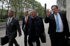 Former FIFA and Nicaraguan soccer official Julio Rocha (2nd R) exits with his lawyers following his hearing at the Brooklyn Federal Courthouse in the Brooklyn borough of New York, U.S. May 18, 2016. REUTERS/Brendan McDermid