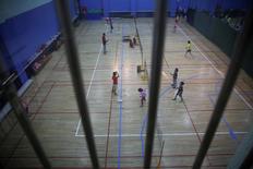 Students practice badminton at the Shichahai sports school in Beijing, China, March 31, 2016. REUTERS/Damir Sagolj