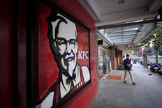 A customer walks out of a KFC restaurant in Shanghai, China, October 9, 2015.  Yum Brands Inc, the owner of KFC and Pizza Hut, releases its first-quarter earnings results after the bell.  REUTERS Aly Song/File Photo