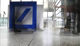 Shareholders of Deutsche Bank arrive for the bank's annual general meeting in Frankfurt, Germany, May 19, 2016. Picture taken with a long exposure.  REUTERS/Kai Pfaffenbach