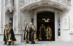 Justices of the Supreme Court leave the new Supreme Court of the United Kingdom after being sworn in at the Middlesex Guildhall in Parliament Square in London, Britain October 1, 2009.  REUTERS/Luke MacGregor/File Photo
