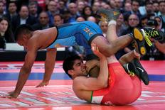 """Mark Hall (blue) of the U.S. faces off with Ahmad Bazrighaleh of Iran as they wrestle in the junior men's freestyle 74 kg/163 lbs """"Beat the Streets"""" event in Times Square, New York, U.S. on May 19, 2016. REUTERS/Adrees Latif"""