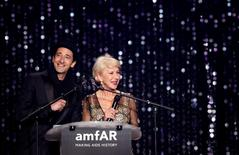 Actor Adrien Brody and actress Helen Mirren conduct an auction during the amfAR's Cinema Against AIDS 2016 event during the 69th Cannes Film Festival in Antibes, near Cannes, France, May 19, 2016.  REUTERS/Jean-Paul Pelissier