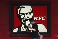 A man walks past a logo of KFC, outside a restaurant in Shanghai, China, July 30, 2015.  REUTERS/Aly Song/File Photo