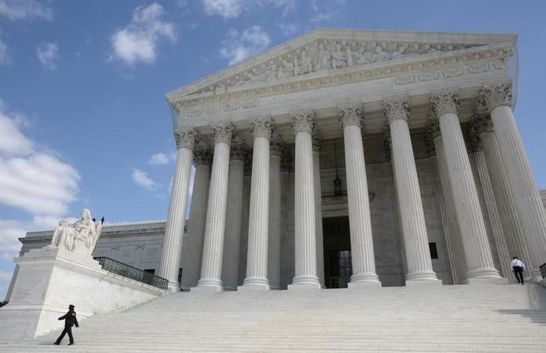 Security guards walk the steps of the Supreme Court in Washington in this file photo dated October 1, 2010. REUTERS/Larry Downing
