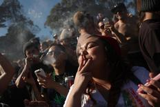 People smoke marijuana joints at 4:20 p.m. as thousands of marijuana advocates gather in Golden Gate Park in San Francisco, California April 20, 2012. REUTERS/Robert Galbraith/File photo