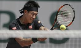 Tennis - French Open - Roland Garros -  Kei Nishikori of Japan vs Andrey Kuznetsov of Russia - Paris, France - 25/05/16.  Kei Nishikori of Japan returns the ball.  REUTERS/Gonzalo Fuentes