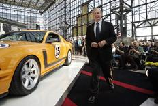 Race car driver Parnelli Jones takes the stage for the unveiling of the 370-horsepower Saleen modified Mustang at the New York International Auto Show in New York in this April 13, 2006 file photo. REUTERS/Keith Bedford