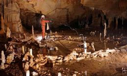 A scientist takes measurements for the archaeo-magnetic survey in the Bruniquel Cave in southwestern France in this undated handout photo after the discovery there of mysterious ring-shaped structures fashioned about 176,500 years ago by Neanderthals. Etienne FABRE - SSAC/Handout via Reuters