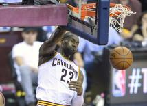 May 25, 2016; Cleveland, OH, USA; Cleveland Cavaliers forward LeBron James (23) dunks in the second quarter against the Toronto Raptors in game five of the Eastern conference finals of the NBA Playoffs at Quicken Loans Arena. Mandatory Credit: David Richard-USA TODAY Sports