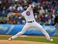 May 14, 2016; Chicago, IL, USA; Chicago Cubs starting pitcher Jake Arrieta (49) delivers a pitch during the first inning against the Pittsburgh Pirates at Wrigley Field. Mandatory Credit: Dennis Wierzbicki-USA TODAY Sports