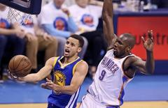 May 24, 2016; Oklahoma City, OK, USA; Golden State Warriors guard Stephen Curry (30) shoots past Oklahoma City Thunder forward Serge Ibaka (9) during the second quarter in game four of the Western conference finals of the NBA Playoffs at Chesapeake Energy Arena. Mandatory Credit: Kevin Jairaj-USA TODAY Sports