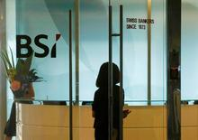 An employee enters the reception area of Swiss bank BSI's office in Singapore May 24, 2016. REUTERS/Edgar Su/File Photo - RTX2EAL5