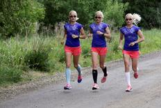 Estonia's olympic team female marathon runners triplets (L-R) Leila, Liina and Lily Luik take part in a training session in Tartu, Estonia, May 26, 2016. REUTERS/Ints Kalnins