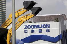 A Zoomlion company logo is seen next to its excavators at an exhibition in Shanghai, November 29, 2012.  REUTERS/Stringer/File Photo