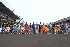 May 27, 2016; Indianapolis, IN, USA; The 33 IndyCar Series drivers pose for a group photo during Carb Day for the Indianapolis 500 at Indianapolis Motor Speedway. Mandatory Credit: Mark J. Rebilas-USA TODAY Sports