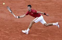 Tennis - French Open - Roland Garros - Novak Djokovic of Serbia v Aljaz Bedene of Britain - Paris, France - 28/05/16. Djokovic returns a shot.  REUTERS/Jacky Naegelen