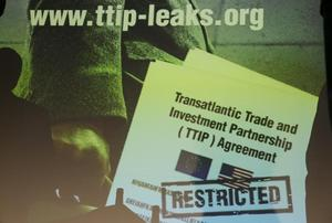 A copy of the leaked TTIP negotiations is projected to a screen during a...