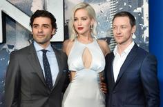 Actor Jennifer Lawrence poses with James MacAvoy (L) and Oscar Isaac at a screening of X-Men Apocalypse at a cinema in London, Britain, May 9, 2016. REUTERS/Hannah McKay