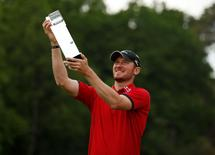 Britain Golf - BMW PGA Championship - Wentworth Club, Virginia Water, Surrey, England - 29/5/16. England's Chris Wood celebrates with the trophy after winning the BMW PGA Championship. Mandatory Credit: Action Images / Andrew Boyers Livepic