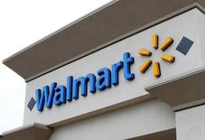 The logo of Down Jones Industrial Average stock market index listed company Walmart is shown on one of its stores in Encinitas, California April 13, 2016.  REUTERS/Mike Blake
