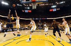 Cleveland Cavaliers guard Kyrie Irving (2) shoots the ball against Golden State Warriors guard Stephen Curry (30) during the third quarter in game one of the NBA Finals at Oracle Arena. Mandatory Credit: Bob Donnan-USA TODAY Sports